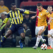 Galatasaray's Milan BAROS (C) and Fenerbahce's Joseph Michael YOBO (L) during their Turkish superleague soccer derby match Galatasaray between Fenerbahce at the Turk Telekom Arena in Istanbul Turkey on Friday, 18 March 2011. Photo by TURKPIX