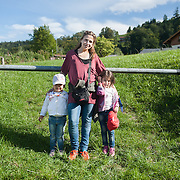 Afternoon, Wednesday 16th of September 2015. Since the border near Salzburg is closed, Aysha decides to go to a small Austrian town and try to cross from there. So they took a train to Hallein and from there a bus to ski resort. When they got off the bus they were really impressed by the green countryside so sake asked me to take a picture of her as a souvenir.