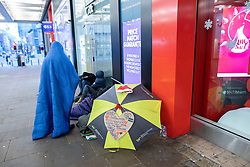 © Licensed to London News Pictures . 25/12/2018 . Manchester , UK . Homeless people sleeping rough outside a branch of Thomas Cook on Market Street in Manchester City Centre on Christmas Day . Photo credit : Joel Goodman/LNP