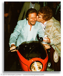 Arlen Ness gets a kiss from his mother Elaine as he rides Orange Blossom into the Oakland Museum of California reception for the California Dream exhibition. Oakland, CA. ©1984 Ness Family Archive Photo