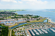 Nederland, Zuid-Holland, Hellevoetsluis 10-06-2015; historische vestingstad en voormalige marinehaven op eiland Voorne-Putten aan het Haringvliet. Het Grootte Dok (jachthaven en passantenhaven).<br /> Historic fortress and former naval base on the island of Voorne-Putten in the Haringvliet.<br /> luchtfoto (toeslag op standard tarieven);<br /> aerial photo (additional fee required);<br /> copyright foto/photo Siebe Swart