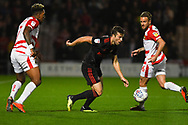 Adam Matthews of Sunderland (2) breaks past Mallik Wilks of Doncaster Rovers (7) and James Coppinger of Doncaster Rovers (26) during the EFL Sky Bet League 1 match between Doncaster Rovers and Sunderland at the Keepmoat Stadium, Doncaster, England on 23 October 2018.