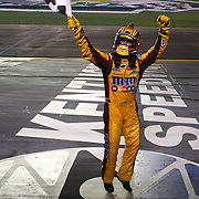09 July 2011: Sprint Cup Series driver Kyle Busch (18) jumps and waves the checkered flag following his win at the Quaker State 400 NASCAR Sprint Cup Series race at Kentucky Speedway in Sparta, KY