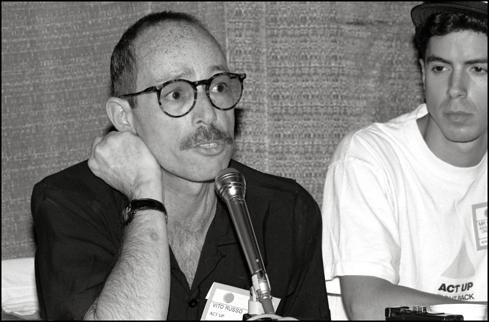 """Vito Russo and Peter Staley of ACT UP speaking on a panel about the possible Antiviral drugs that could be used to combat HIV/AIDS at the Fifth International AIDS Conference.<br /> <br /> Vito Russo was an American LGBT activist, film historian and author. He wrote The Celluloid Closet, described in The New York Times as """"an essential reference book"""" on homosexuality in the US film industry, co-founded the Gay and Lesbian Alliance Against Defamation, a media watchdog organization that strives to end anti-LGBTQ rhetoric, and advocated for LGBTQ inclusion in popular media. Russo was diagnosed with HIV in 1985, and died of AIDS-related complications in 1990. <br /> <br /> Peter Staley is an American political activist, known primarily for his work in HIV/AIDS activism. As a member of ACT  UP,  New York, he co-founded both the Treatment Action Group (TAG) and the educational website AIDSmeds.com."""