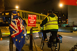 "Pro-Remain and People's Vote campaigner Steve Bray welcomes a bus emblazoned with ""Bollocks to Brexit: to Old Palace Yard outside Parliament.. Westminster, London, December 20 2018."