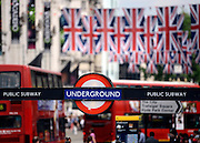 © Licensed to London News Pictures. 30/05/2012. London, UK A view down Piccadilly showing an underground sign and Union Flag bunting across the street. Preparations today 20th May 2012 around London ahead of The Queen's Diamond Jubilee this weekend. Photo credit : Stephen Simpson/LNP