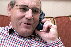 Portrait of an older man on the phone,