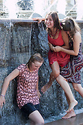 Moscow, Russia, 16/07/2010..Teenage girls dive and swim in fountains next to the Kremlin and Red Square during a prolonged heatwave that has seen temperatures of over 37C, a record for the city.