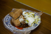 Fermented tofu on a plate at a Stinky tofu restaurant in Taipei, Taiwan.