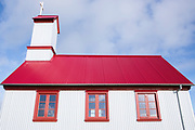 Traditional quaint Icelandic corrugated iron church with red roof Pykkvabaejarklauster at Alftaver,  South Iceland built 1864