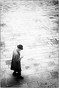 Lone man walking across the campo