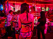 27 FEBRUARY 2019 - BANGKOK, THAILAND: A tattoo on the back of a woman who works in a bar of Soi Cowboy in Bangkok. Bangkok, a city of about 14 million, is famous for its raucous nightlife. But Bangkok's real nightlife is seen in its markets and street stalls, many of which are open through the night.      PHOTO BY JACK KURTZ
