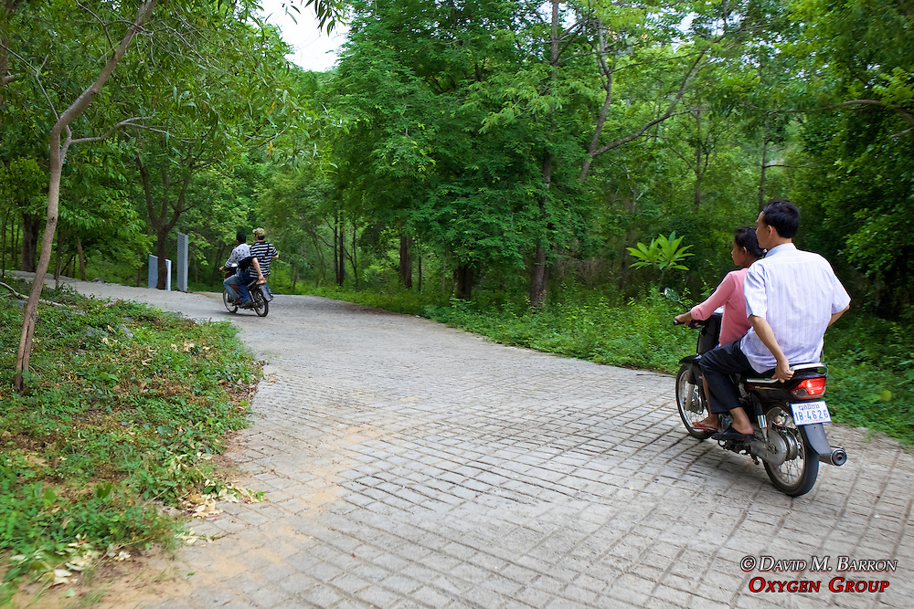 Going Up Mountain To Phnom Sampeau Pagoda On Scooters