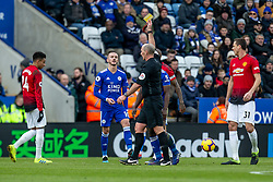 February 3, 2019 - Leicester, England, United Kingdom - Referee Mike Dean gives James Maddison of Leicester City a yellow card during the Premier League match between Leicester City and Manchester United at the King Power Stadium, Leicester on Sunday 3rd February 2019. (Credit Image: © Mi News/NurPhoto via ZUMA Press)