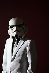 © Licensed to London News Pictures . 16/12/2015 . Manchester , UK . Smartly dressed Storm Trooper in the cinema . Star Wars fans attend the midnight screening of Star Wars the Force Awakens at the AMC Great Northern cinema in Manchester City Centre . Photo credit : Joel Goodman/LNP