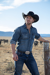 sexy cowboy on a cattle ranch