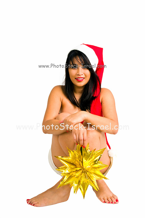 Young sexy Asian woman wearing Santa hat