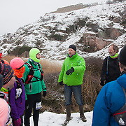 Marathon runners get a bit of advice on the route and the weather ahead.  Salomon Hammer Trail Winter Edition is a first on Bornholm and is one of the toughest routes in Denmark. The 4 runs consist of a 50 mile run, a marathon, a 1/2 marathon and 10k all run a on an approximate 25km route which includes 860 meter vertical rise on the North East coast of the Danish island Bornholm. The cut-off time for the 50mile run was 16 hours and more than a hundred runners made it to the finishing line. The last runner across the line after 50 miles  was in after 15:14:40