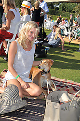 LUCY ROBERTS and Henry the dog at a cricket match to in aid of CARE - Corfu Animal Rescue Establishment held at Hawkley Cricket Club, Hawkley, Hampshire on 8th September 2012.