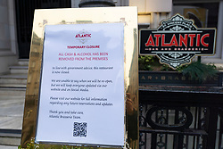 Notice of closure due to Coronavirus outside Atlantic bar and restaurant in central Glasgow, Scotland, UK, Scotland, UK