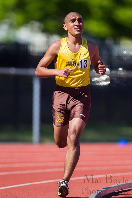 Rowan University sophomore Raj Singh competes in men's 10,000 meters at the NJAC Track and Field Championships at Richard Wacker Stadium on the campus of  Rowan University  in Glassboro, NJ on Saturday May 4, 2013. (photo / Mat Boyle)
