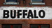 SHOT 10/24/17 10:07:18 AM - Peeling and faded Buffalo signage at Buffalo X-Ray in downtown Buffalo, N.Y. Buffalo, N.Y. is the second most populous city in the state of New York and is located in Western New York on the eastern shores of Lake Erie and at the head of the Niagara River. By 1900, Buffalo was the 8th largest city in the country, and went on to become a major railroad hub, the largest grain-milling center in the country and the home of the largest steel-making operation in the world. The latter part of the 20th Century saw a reversal of fortunes: by the year 1990 the city had fallen back below its 1900 population levels. (Photo by Marc Piscotty / © 2017)