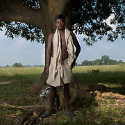 Sanjeeb Dhurua (28) near his field at Bhalutudhia village. The village will soon be relocated to a resettlement colony as it?s land was allotted to an industrial project.