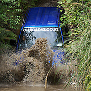 Vehicles navigate the elements at Off Road NZ,  a sustainable premium adventure four wheel driving experience.  Off Road NZ is located on a beautiful NZ native bush clad property on the Mamaku Plateau, just 20 minutes north of Rotorua City. The formerly volcanic landscape offers diverse terrain for self-drive 4WD vehicles and other adventures.  Amoore Road, Rotorua, New Zealand. 13th December 2010 Photo Tim Clayton.