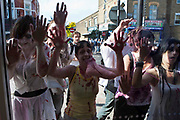 Zombies at the window of Sainsburys Express, Stoke Newington. Around 300 local residents of Stoke Newington took part in a Zombie demonstration against a proposed Sainsbury development in the heart of Stoke Newington. The development will overlook one of the oldest cemeteries in London. The protesters marched through the centre of Stoke Newington giving a clear message to the developers that a new store is not wanted. Stokey Local, the organisers of the protest believe it will have a huge negative impact on the infrastructure and jobs in the area.