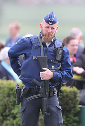 An armed police man on patrol ahead of a ceremony at the Island of Ireland Peace Park in Messines, Belgium to commemorate Battle of Messines Ridge.