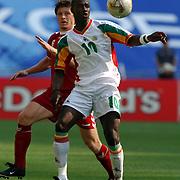 Denmark's Thomas Helveg watches Senegal's Khalilou Fadiga