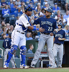 August 4, 2017 - Kansas City, MO, USA - Kansas City Royals catcher Salvador Perez congratulates the Seattle Mariners' Robinson Cano (22) at the end of the Mariners' first inning in which Cano connected on his 500th career double at Kauffman Stadium in Kansas City, Mo., on Friday, Aug. 4, 2017. (Credit Image: © John Sleezer/TNS via ZUMA Wire)