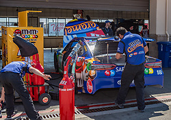 June 22, 2018 - Sonoma, CA, U.S. - SONOMA, CA - JUNE 22:  The pit crew for Kyle Busch, driving the (18) Toyota for Joe Gibbs Racing prepares their car on Friday, June 22, 2018 at the Toyota/Save Mart 350 Practice day at Sonoma Raceway, Sonoma, CA (Photo by Douglas Stringer/Icon Sportswire) (Credit Image: © Douglas Stringer/Icon SMI via ZUMA Press)