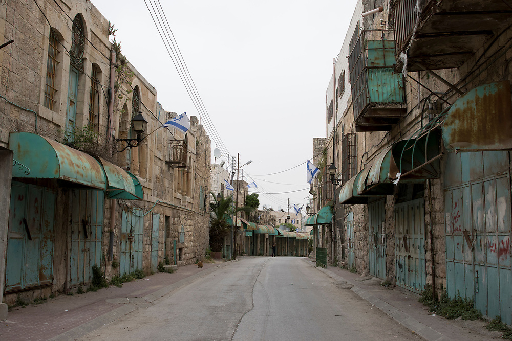 Shuhada Street, once the main economic hub in Hebron, has been almost entirely closed to Palestinians since 1994
