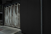 Curtained entrance to industrial unit. Kyoto Japan