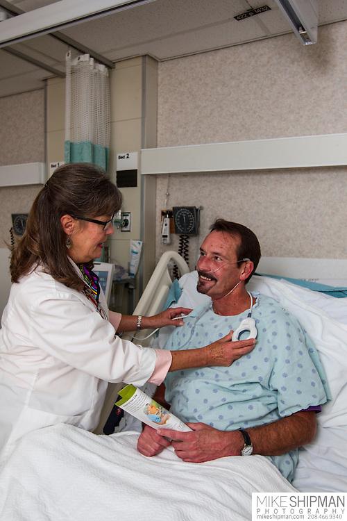 Advanced procedures, Julie Marcum explains the pacemaker programming procedure to patient Brice Mateo at the Boise Veterans Administration Medical Center, Robert Wood Johnson Foundation, Julie Marcum, nurse, Brice Mateo, talent, MR