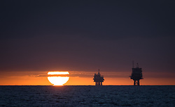 © Licensed to London News Pictures. 27/11/2016. Wick, UK.  Sunset over the Beatrice A & B oil platforms in the Moray Firth this evening, 27th November 2016.  Photo credit: Rob Arnold/LNP