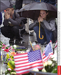 © Andre Pichette/ABACA. 28657-21. New York City-NY-USA. 14/09/2001. People bring flowers and paid tribute att the Union Square after the tragedy ofWorld trade center collapsed fourth days ago caused by a terrorist attack.  | 28657_21