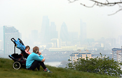 File photo dated 02/04/14 of pollution hanging over London. High levels of air pollution could be blamed for a bad night's sleep, research has suggested.
