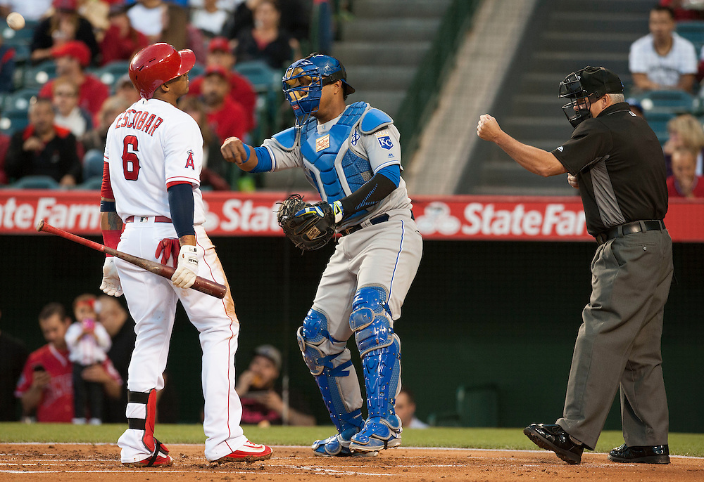 The Angels Yunel Escobar doesn't look happy after striking out looking in front of Royals catcher Salvador Perez and home plate umpire Tim Timmons Wednesday night at Angel Stadium.<br /> <br /> ///ADDITIONAL INFO:   <br /> <br /> angels.0428.kjs  ---  Photo by KEVIN SULLIVAN / Orange County Register  --  4/27/16<br /> <br /> The Los Angeles Angels take on the Kansas City Royals Wednesday at Angel Stadium.<br /> <br /> <br />  4/27/16