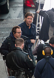 "Day two of filming. Brad Pitt on the set of the movie ""World War Z"" being shot in the city centre of Glasgow. The film, which is set in Philadelphia, is being shot in various parts of Glasgow, transforming it to shoot the post apocalyptic zombie film..© pic : Michael Schofield."