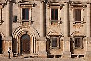 Tourist taking photograph at Palazzo de Nobili Tarugi, in Piazza Grande in Montepulciano, Val D'Orcia, Tuscany, Italy