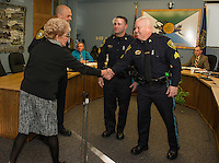 Ann Kaligian and Chief Chris Adams congratulate Detective Benjamin Black and Detective Kevin Butler on their promotion during the Laconia Police Commissioners meeting at City Hall Thursday afternoon.  (Karen Bobotas/for the Laconia Daily Sun)