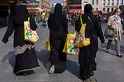 Muslim women in Islamic dress on a shopping trip in London's West End.