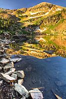 The shoreline of Cecret Lake in Utah at sunrise.