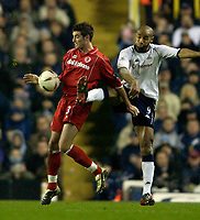 Photo. Jed Wee.<br /> Tottenham Hotspur v Middlesbrough, Carling Cup, White Hart Lane, London. 17/12/2003.<br /> Spurs' Federic Kanoute (R) sticks a foot out to try to dispossess Middlesbrough's Franck Queudrue.