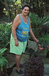 Portrait of woman standing in garden in Soroa; Cuba,