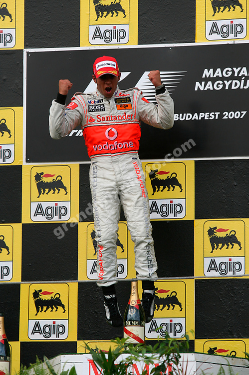 Lewis Hamilton (McLaren-Mercedes) jumps for joy on the podium after the 2007 Hungarian Grand Prix at the Hungaroring. Photo: Grand Prix Photo