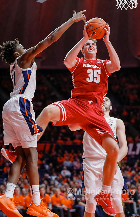 CHAMPAIGN, IL - JANUARY 23: Nate Reuvers #35 of the Wisconsin Badgers shoots the ball against Ayo Dosunmu #11 of the Illinois Fighting Illini at State Farm Center on January 23, 2019 in Champaign, Illinois. (Photo by Michael Hickey/Getty Images) *** Local Caption *** Nate Reuvers; Ayo Dosunmu