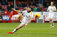 Cambridge United midfielder James Dunne (4) clears the ball from danger during the EFL Sky Bet League 2 match between Crawley Town and Cambridge United at the Checkatrade.com Stadium, Crawley, England on 12 November 2016. Photo by Andy Walter.